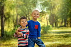 Two friend boys. Hugging and having fun in summer park Stock Photography