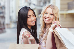 Two friend having fun at shopping Stock Images