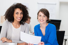 Two friendly businesswoman at the office Royalty Free Stock Photo