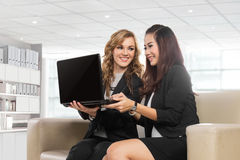 Two friendly businesswomen sitting and discussing new ideas, iso Royalty Free Stock Photos