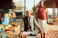 Two friendly senior meet on indian street and make pose Royalty Free Stock Photo