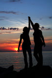 Two Friends. Silhouette of two friends at sunset Royalty Free Stock Photography