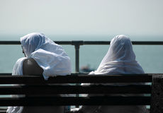 Two Friends. Two lady Muslims, by the coast, England Stock Photo