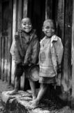 Two friends. Two Zafimaniry (Madagascar) kids smile at my camera at their town Royalty Free Stock Photo