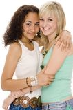Two Friends. Two attractive young women in colorful casual clothing on white background Stock Photo