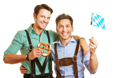 Two friends in bavaria with pretzel Stock Images