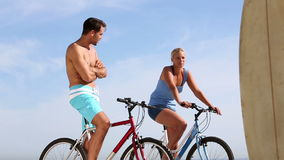 Two friends on bikes speaking stock footage