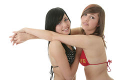 Two friends in bikini swimsuits Royalty Free Stock Images