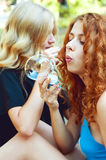 Two friends blowing soap bubbles Stock Photography