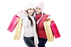 Two friends bring shopping bags, isolated in white Royalty Free Stock Images