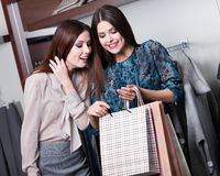 Two friends buy gifts with a rebate Royalty Free Stock Photo