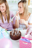 Two friends celebrating a birthday with presents Stock Images