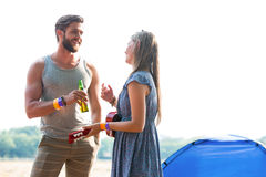 Two friends chatting in campsite Stock Photo