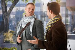 Two friends chatting outdoors Stock Images