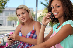 Two friends chatting Royalty Free Stock Image