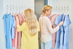 Two friends in a clothing store stock photo