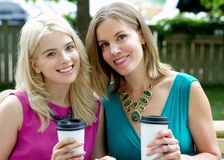 Two friends. With coffee in park Stock Images