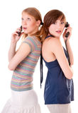 Two friends communicate by phones Royalty Free Stock Photos