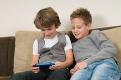 Two friends on a computergame royalty free stock photo