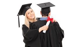 Two friends congratulating each other's graduation Stock Image