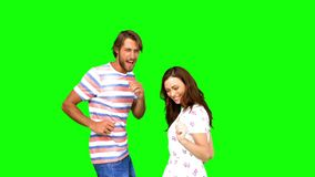 Two friends dancing together on green screen. In slow motion stock video footage