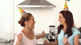 Two friends dancing together in the kitchen stock video