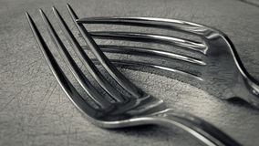 Two friends. Detail view of two forks in black and white Stock Photos