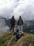 Two Friends and a Dog. This image of the two hikers and the dog on a cloudy day in the mountains was taken in western MT Stock Photos