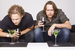 Two friends drinking at home Royalty Free Stock Photography