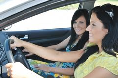 Two friends driving in car Royalty Free Stock Photography