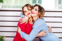 Two friends embrace. The concept of lifestyle and friendship. Two friends embrace. The concept of lifestyle and friendship and hug Stock Image