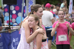 Two friends at the end of race for life. Royalty Free Stock Photography