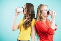 Two friends enjoy a morning coffee stock images