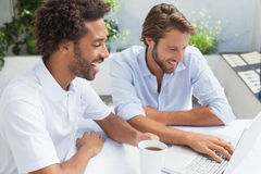 Two friends enjoying coffee together with laptop Stock Photos