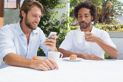 Two friends enjoying coffee together Royalty Free Stock Photography