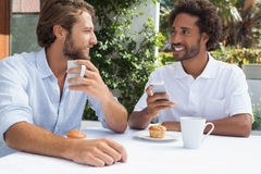 Two friends enjoying coffee together Royalty Free Stock Images