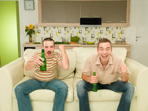 Two friends enjoying a football match Stock Photo