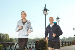 Two friends enjoying a morning jog Stock Images
