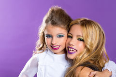 Two friends fashiondoll kid girls with fashion purple makeup Stock Image
