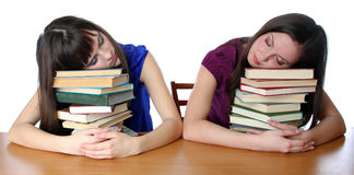 Two friends fell asleep on the books Stock Images