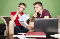 Two friends focused while studying. Two teenage friends focused on studying Stock Photography
