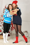 Two friends girls give present Royalty Free Stock Photography