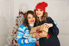 Two friends girls give present Royalty Free Stock Images