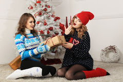 Two friends girls give present Stock Images