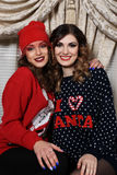 Two friends girls in sweaters . Funny celebration a new year or christmas royalty free stock image