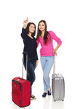Two friends girls with travel suitcases Stock Photo