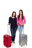 Two friends girls with travel suitcases Stock Image