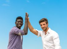 Two friends giving high five Stock Photo