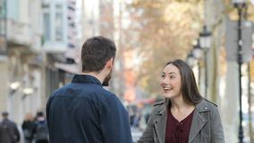 Friends giving five in the street. Two friends giving high five in a city street stock footage