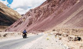Two Friends Go By Motorcycle By The Leh - Manali Highway In High Himalayas Mountain, India. Stock Photo